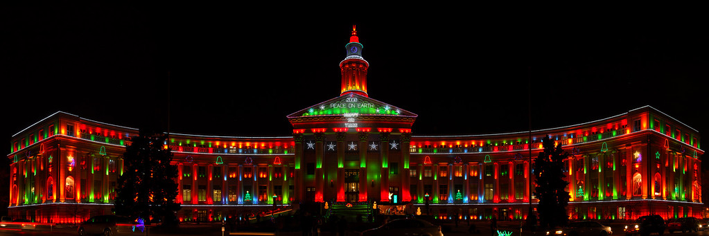 The Denver City and County building in the new low voltage led holiday light. This panorama  was made with 9 vertical photos. I stood on the other side of the street dead center. It took 10mins to level things out for the photo. I took 4 runs of photos as the lights changed to red blue and green. EQU 45mm lens iso 100 f8 1.6sec nikon D200. This was not wide angle.