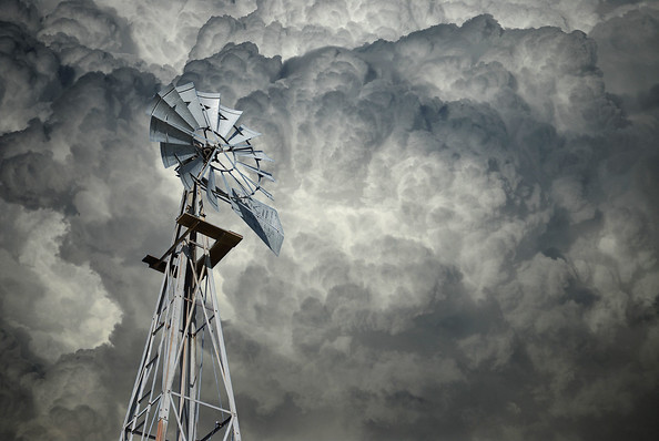 Clouds and windmill in full sun.