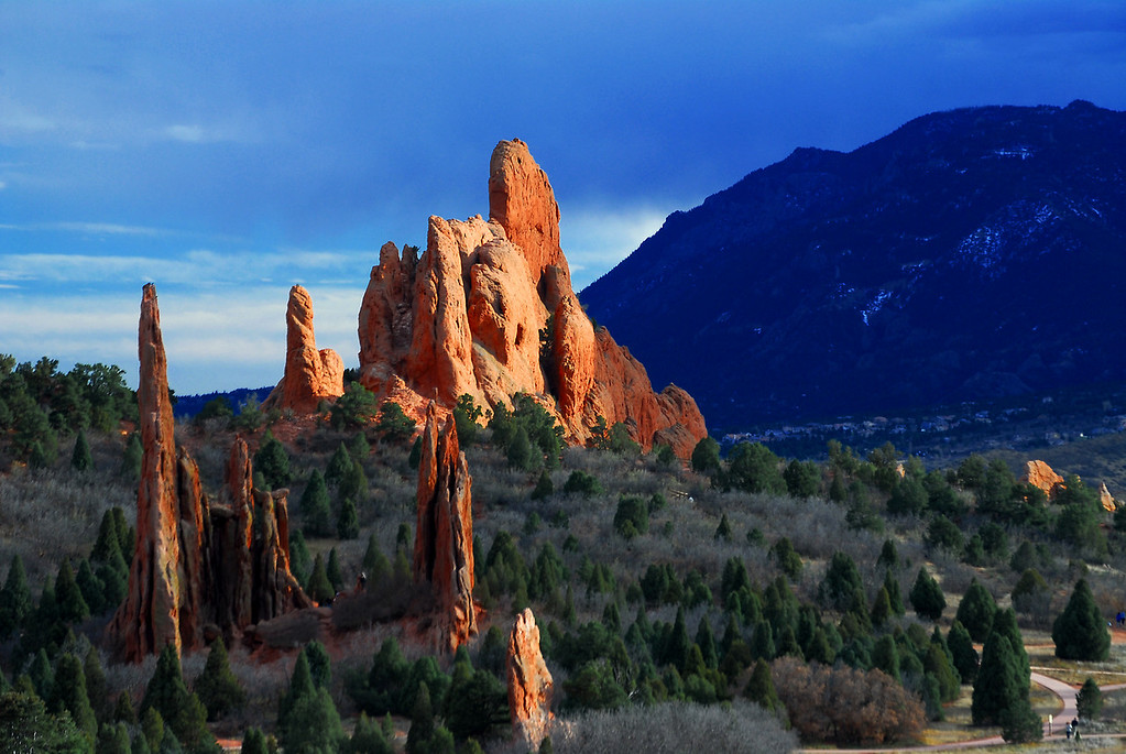 Garden of the Gods Colorado Landscape.  The Rich reds in the rock were brought out by the full sunlight and dark passing storm.  Daniel P Woods.